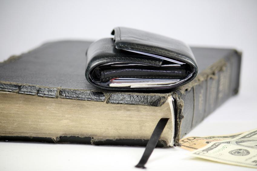 wallet sitting on bible